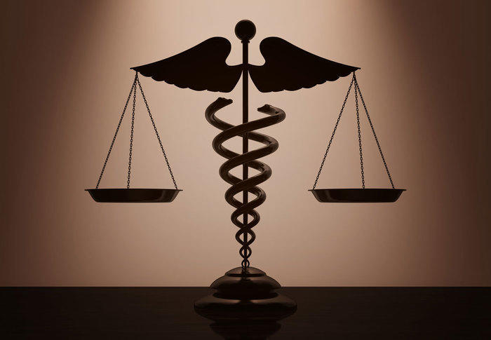Medical Caduceus Symbol as Scales