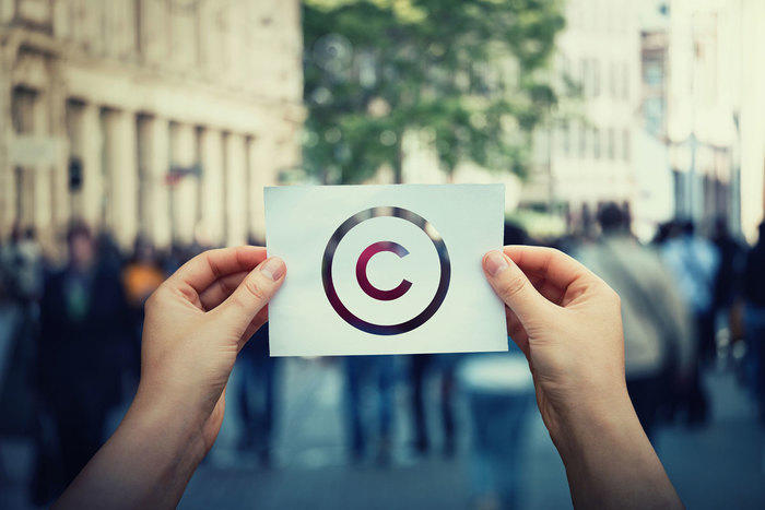 Person holding paper with copyright symbol